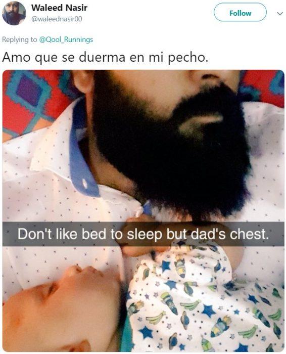 Bebé dormido en el pecho de su papá con barba tupida