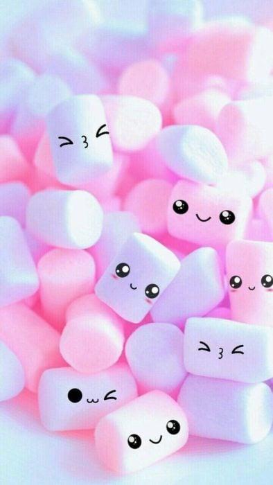 fondo de pantalla para celular estilo kawaii con bombones de color rosa y lila con ojos saltones