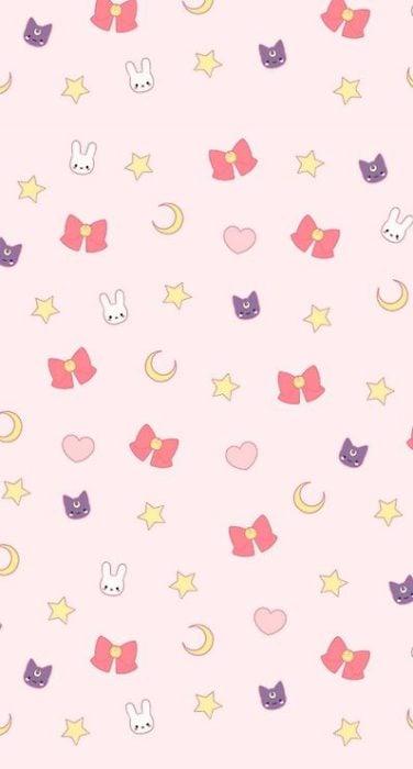 Fondo de pantalla para celular inspirado en Sailor Moon con moños rojos, medias lunas, conejos y gatos