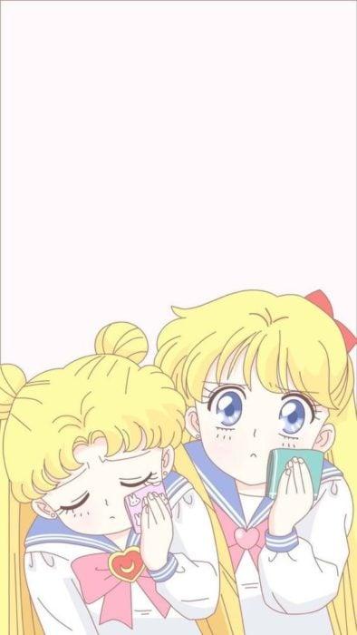 Fondo de pantalla para celular inspirado en Sailor Moon con Serena y Sailor Venus