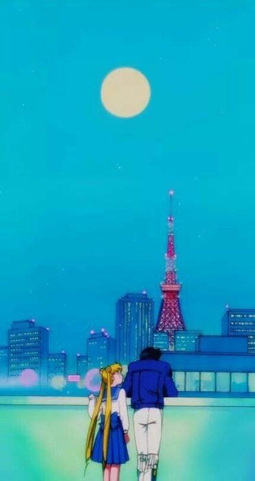 Fondo de pantalla para celular inspirado en Sailor Moon con Serena y Darien mirando el mar