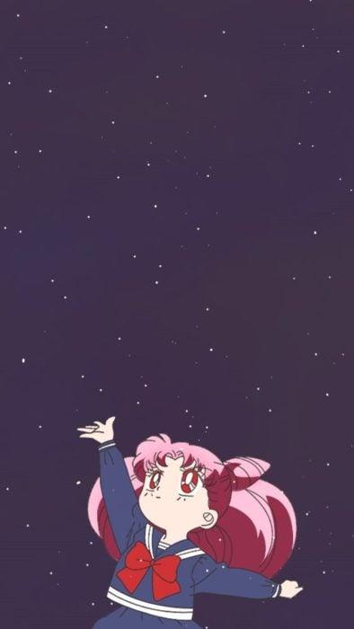 Fondo de pantalla para celular inspirado en Sailor Moon con Serena en plena transformación a Sailor Moon con una pequeña de cabello rosado estirando sus manos para alcanzas las estrellas