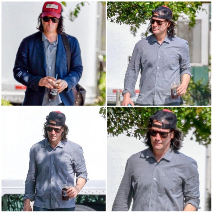 Keanu Reeves caminando por las calles, subriendo su rostro con gafas y gorra