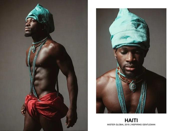 Hombre concursante de Mister Global se visten con su traje regional de Haiti