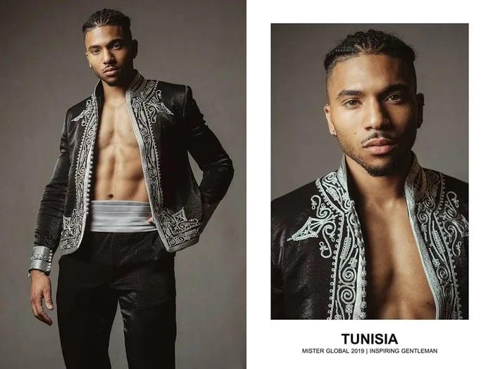 Hombre concursante de Mister Global se visten con su traje regional de Tunisia