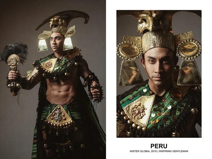 Hombre concursante de Mister Global se visten con su traje regional de Perú