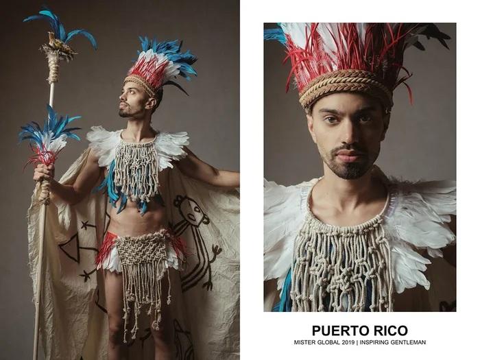 Hombre concursante de Mister Global se visten con su traje regional de Puerto Rico