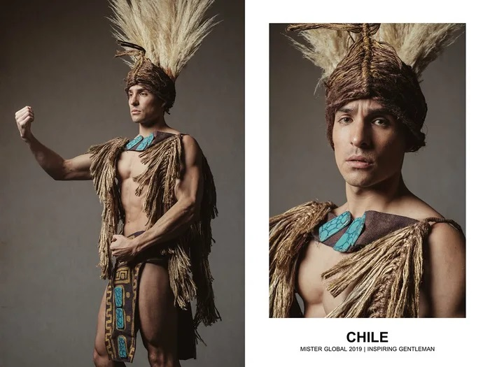 Hombre concursante de Mister Global se visten con su traje regional de Chile