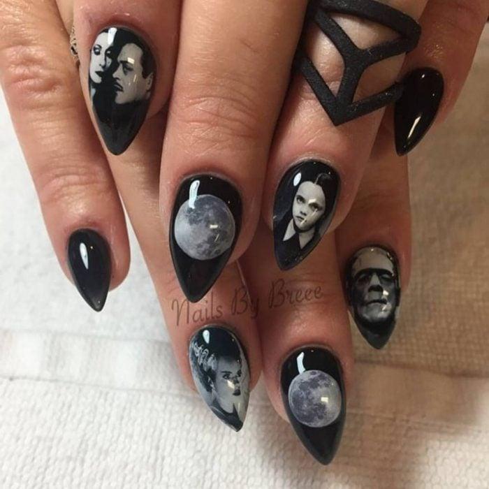 Uñas con manicura estilo bruja para Halloween; los locos Addams; stiletto