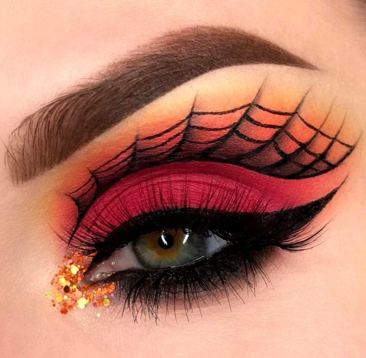 Maquillaje de ojos de Halloween; sombra roja y anaranjada con telaraña