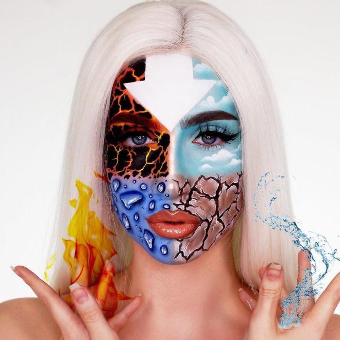 Chica con una peluca de color platinada con el rostro pintado con los 4 elementos