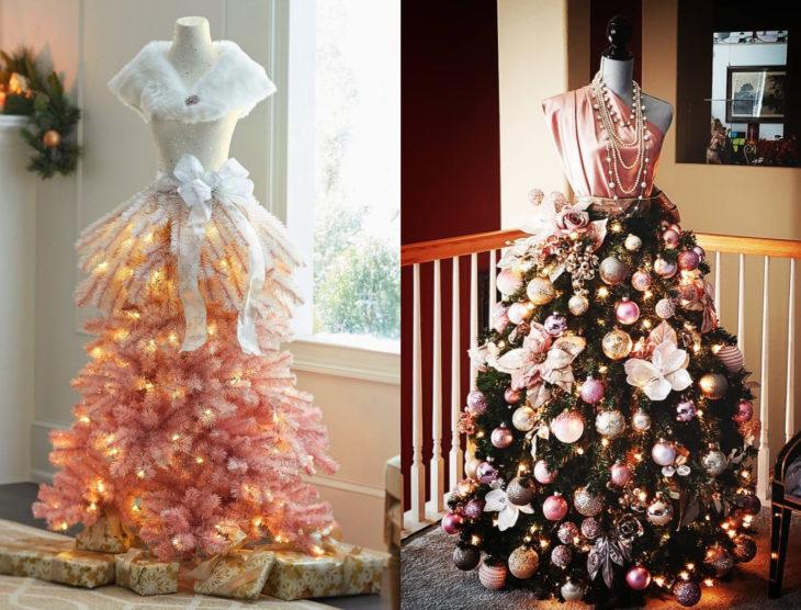 Árbol rosa de Navidad como vestido de maniquí con moños, esferas y collares