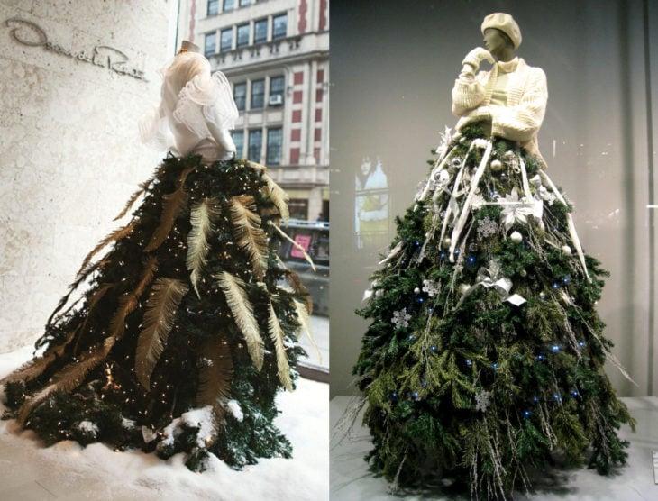 Árbol verde de Navidad como vestido de maniquí con plumas doradas