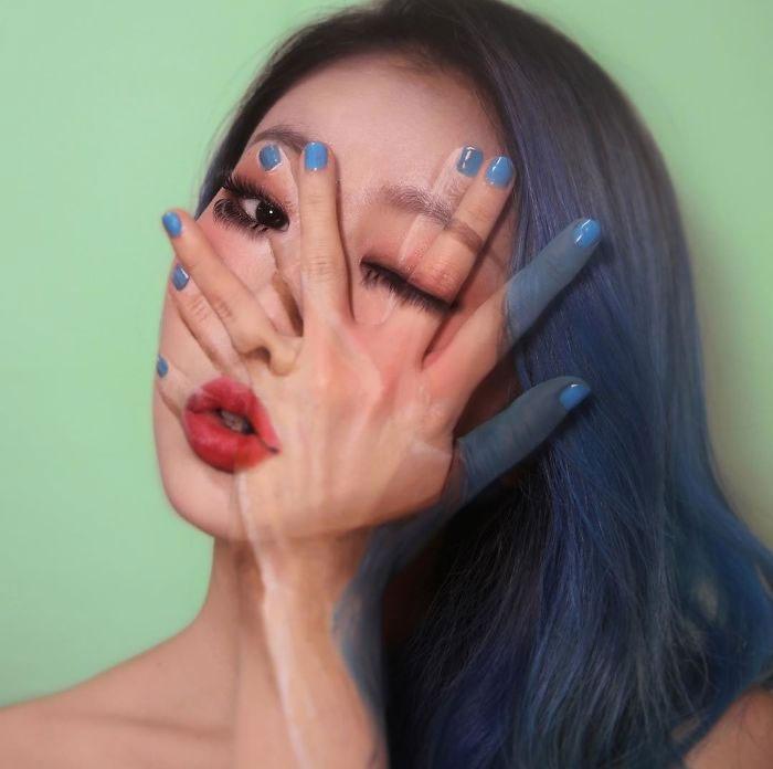 Dain Yoon, artista maquillaje, pintura recreando sus manos sobre su trostro