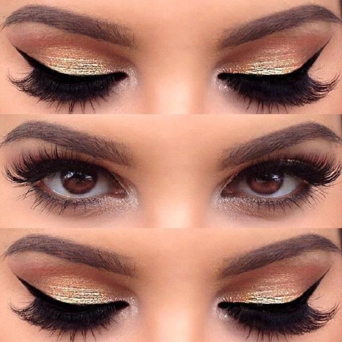 Maquillaje de sombra dorada metálica con delineado negro