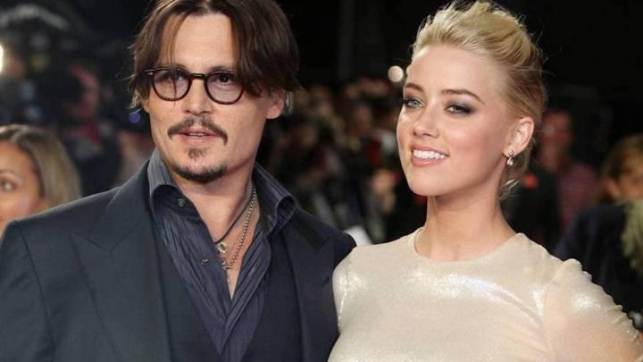 Amber Herad y Johnny Depp en una alfombra roja