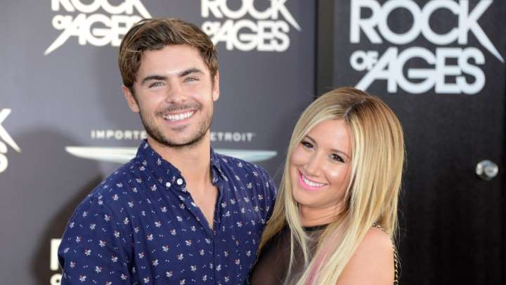 Ashley Tisdale y Zac Efron en una alfombra roja