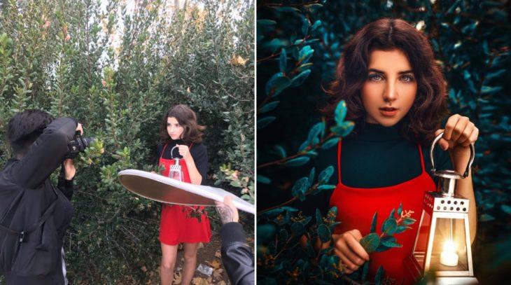 Detrás de cámaras de fotografía de chica en el bosque sosteniendo lampara