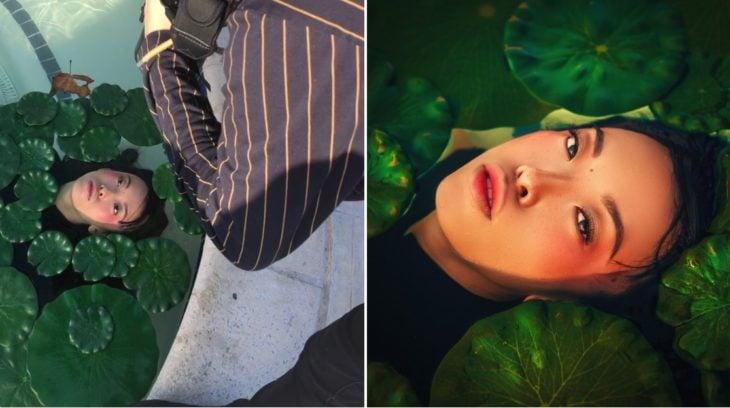 Detrás de cámaras de fotografía de modelo dentro de una fuente con hojas al rededor de su rostro