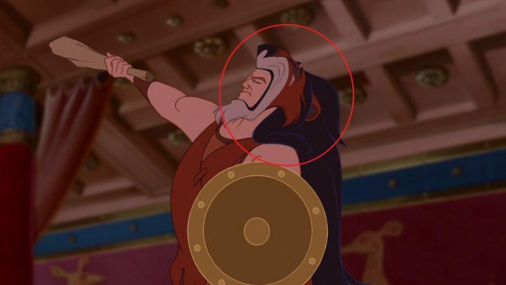 Hércules con una cabeza de león posando