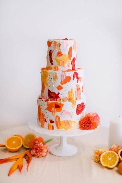 Pastel de betún de vainilla con cascara de naranja y toronja