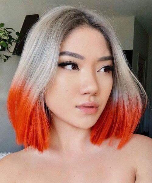 Melena plateada con puntas naranjas