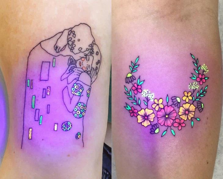 Estilos de tatuajes femeninos; tatuaje fluorescente de El Beso de Gustav Klimt y flores