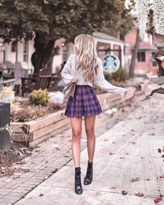 Blonde girl with checkered pleated skirt