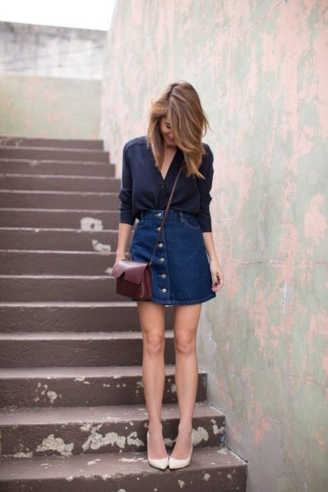 Girl in A-cut denim skirt and black blouse