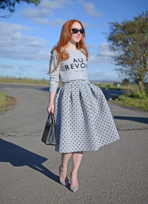 Redhead woman in long gray skirt