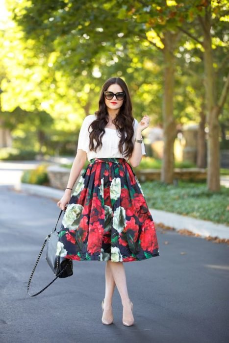 Woman in long flowery skirt and white blouse