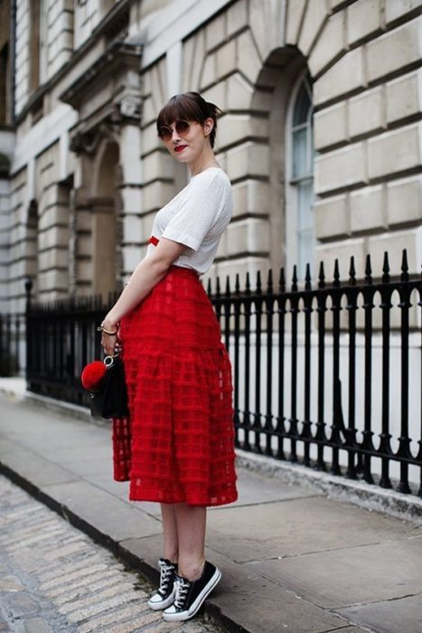 Woman in white blouse and red skirt