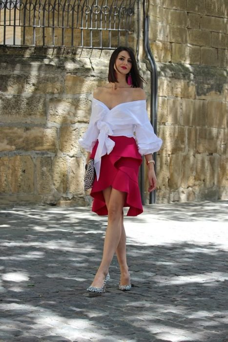 Woman in white blouse and red peplum skirt