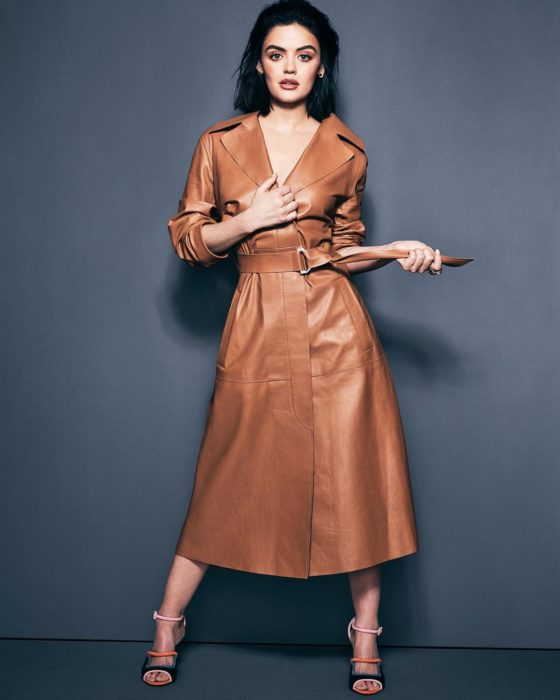 Lucy Hale llevando un vestido de cuer café y posando para una revista
