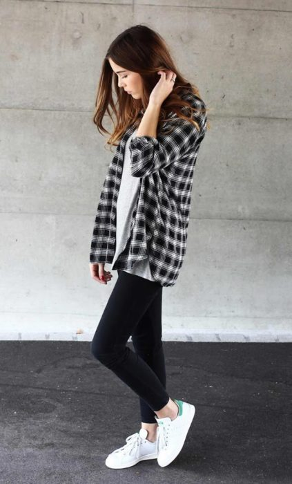 Girl wearing black jeans, white basic shirt and plaid shirt