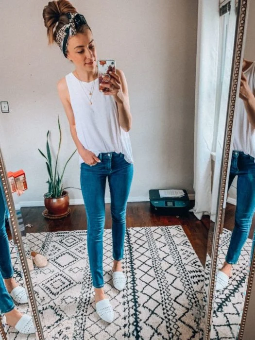 Girl wearing jeans and a white basic shirt