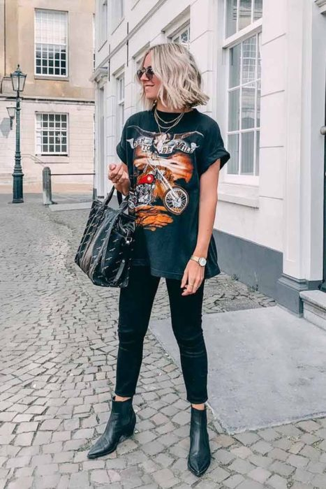 Girl wearing skinny jeans and rock t-shirt with booties
