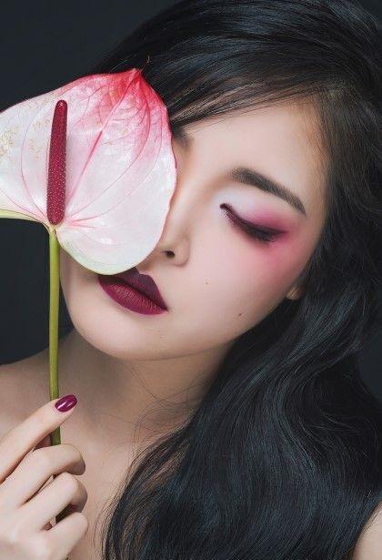 Chica con maquillaje replica de Mulan de Disney