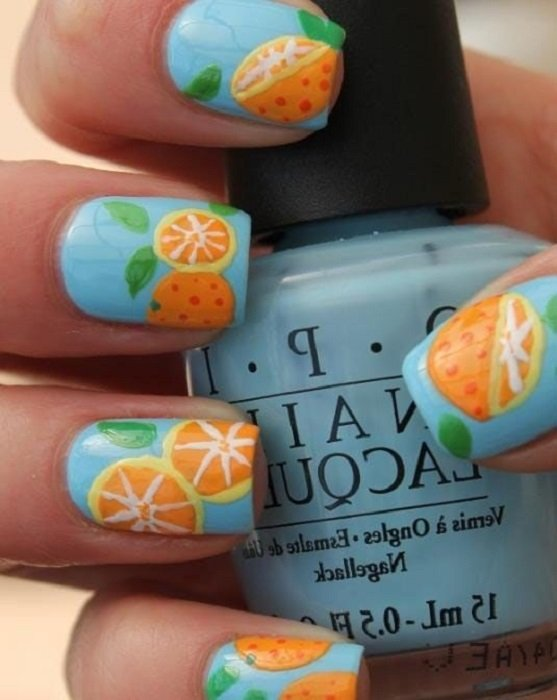 Diseño de manicure de naranjas