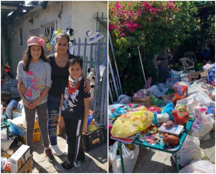 Familia reunida en el frente se su casa recibiendo ayuda de despensa