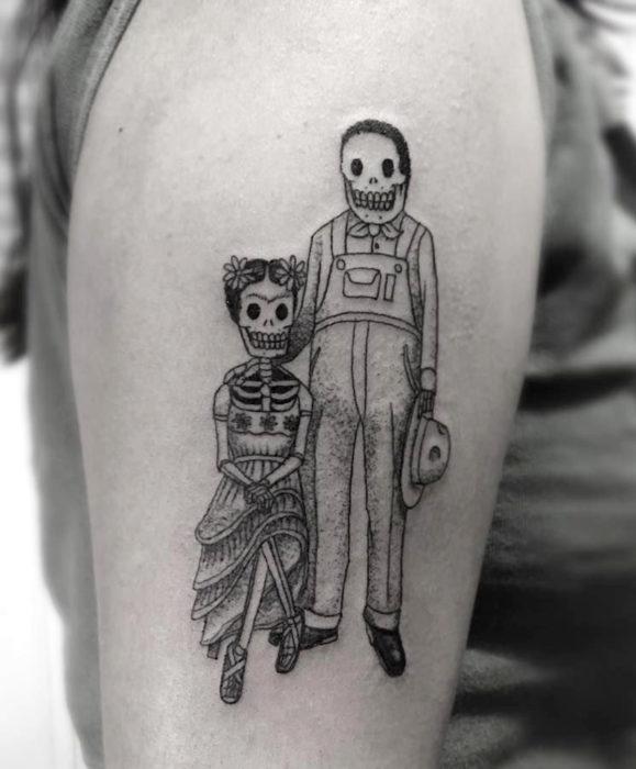 Tatuajes de Frida Kahlo y Diego Rivera como catrinas