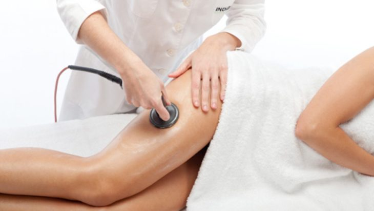 Girl getting treatment for her legs with cellulite