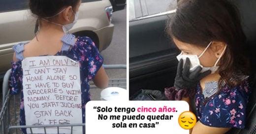 Mamá coloca un cartel a su hija para que dejen de criticarla por llevarla al supermercado