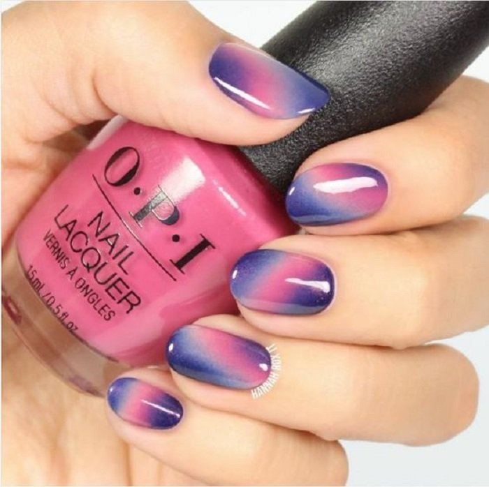 Manicure in lilac tones with a gradient of shades with shine