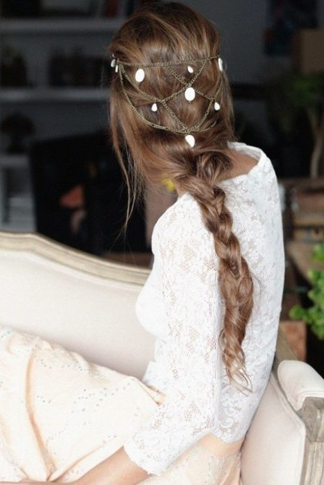 Braided hair and chain crown decorating the nape