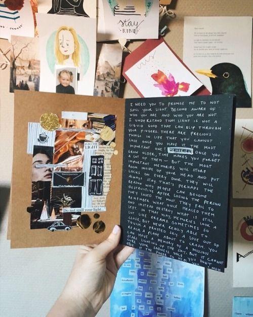 Libreta en hojas de color negro con recortes de revista y decorada con pluma blanca