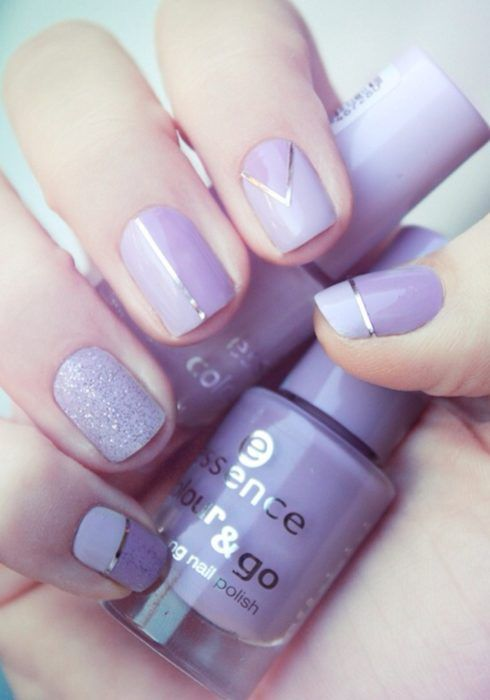 Manicure in lilac tones with glitter and silver decorations