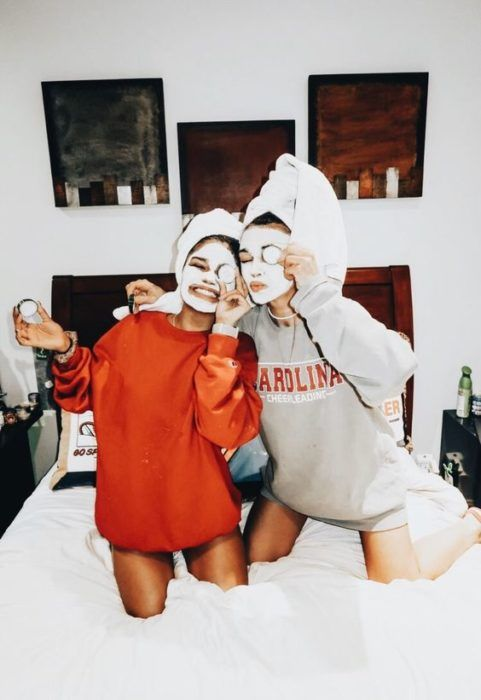 Girls wearing oatmeal masks and pine slices taking a funny photo