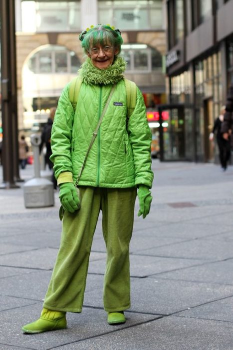 Elderly woman with phosphorescent green hair and outfit