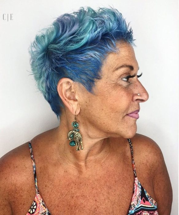 Older woman with short turquoise pixie style hair
